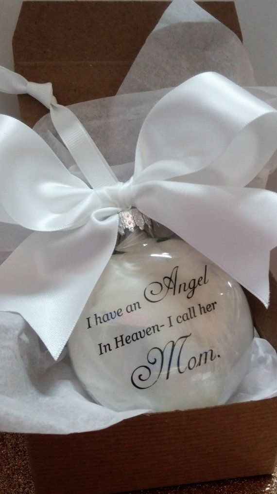 Beautiful feather filled glass memorial ornament. It is approx. 3.5 inches (10cm) in dimension and just over 1 inch thick. The inside is filled with soft white feathers and the words I have an Angel in Heaven, I call her Mom. printed on white vellum, also inside the ornament. **If you would like to replace Mom with another word, such as Mama, Momma, Mother, Son etc, please let me know in the comments to seller box at checkout.**  I can add a name to the ornament at no additional charge- just…