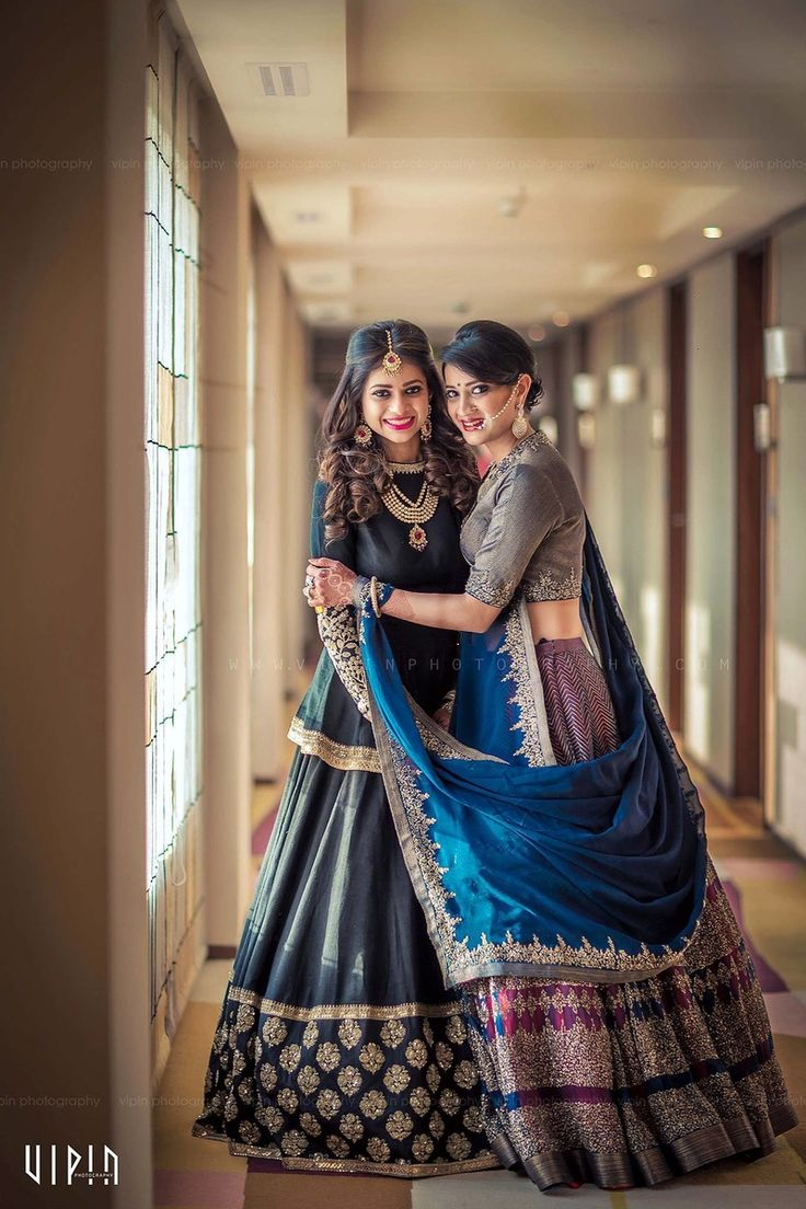 Sister of the Bride - Bride in a Black Lehenga with a Golden Broad Border and the Sister in a Blue and Grey Lehenga | WedMeGood | #wedmegood #sisterofthebride #indianbride #indianwedding