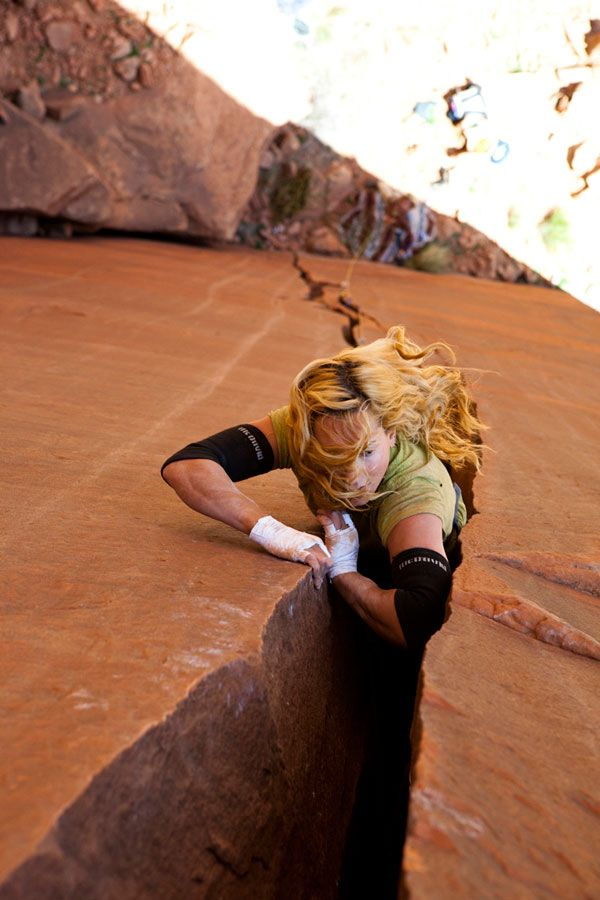 Pamela Shanti Pack locks off a chicken-wing in The Dentist's Chair (5.11d), Indian Creek