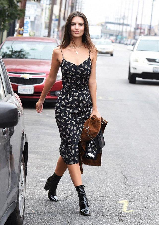 OnEmily Ratajkowski: Harley Viera Newton dress; A.L.C. Blaine Studded Suede Jacket($873);Gianvito Rossi Patent Leather Rolling High Booties($995);Céline handbag.