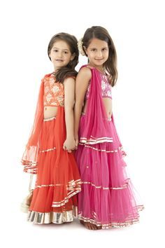 A great option for casual summer wear is a halter dress in bright colors. A knee length or a mid length halter dress with elastic tie ups at the neck and tiered double ruffles and skirts is a good option for a casual dress. Choose such girls clothing in fabrics like cotton voile and linen for a comfortable fit.