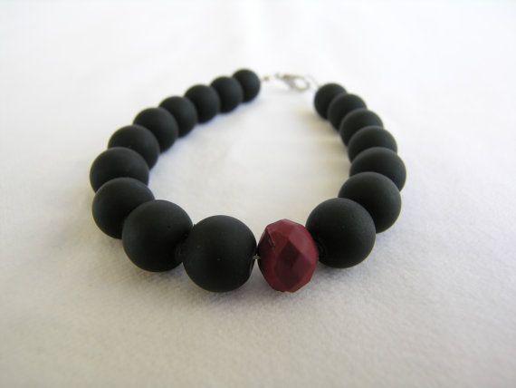 Bracelet with matt black glass beads and a bordeaux by GIASEMAKI