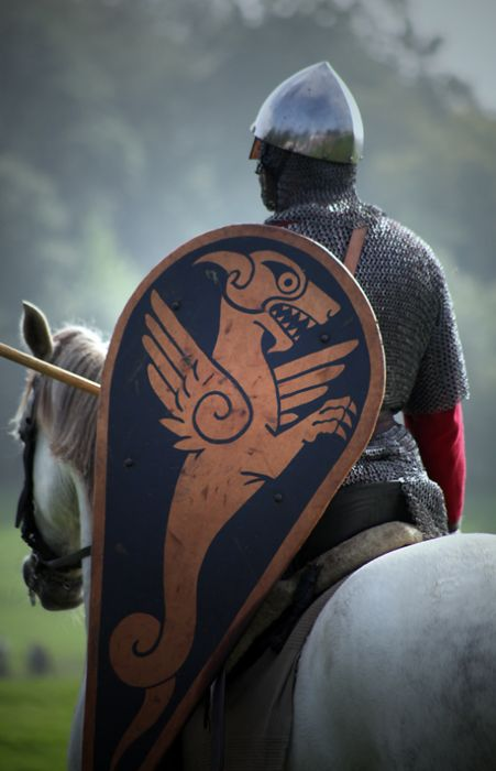 Norman knight with conical helmet, lance and kite shaped shield