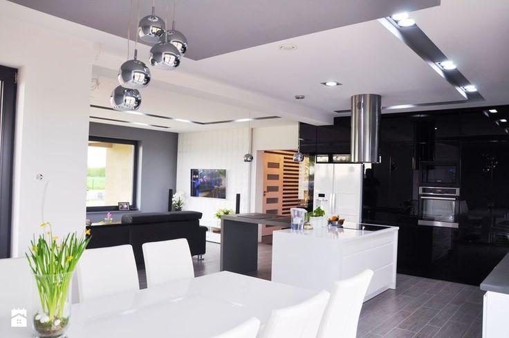 Jadalnia z widokiem na kuchnie i salon Kuchnia - zdjęcie od Am Design Studio projektowania wnętrz