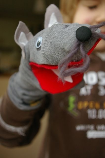 wolf puppet made from a sock - the kids love playing with these while listening to Peter and the Wolf