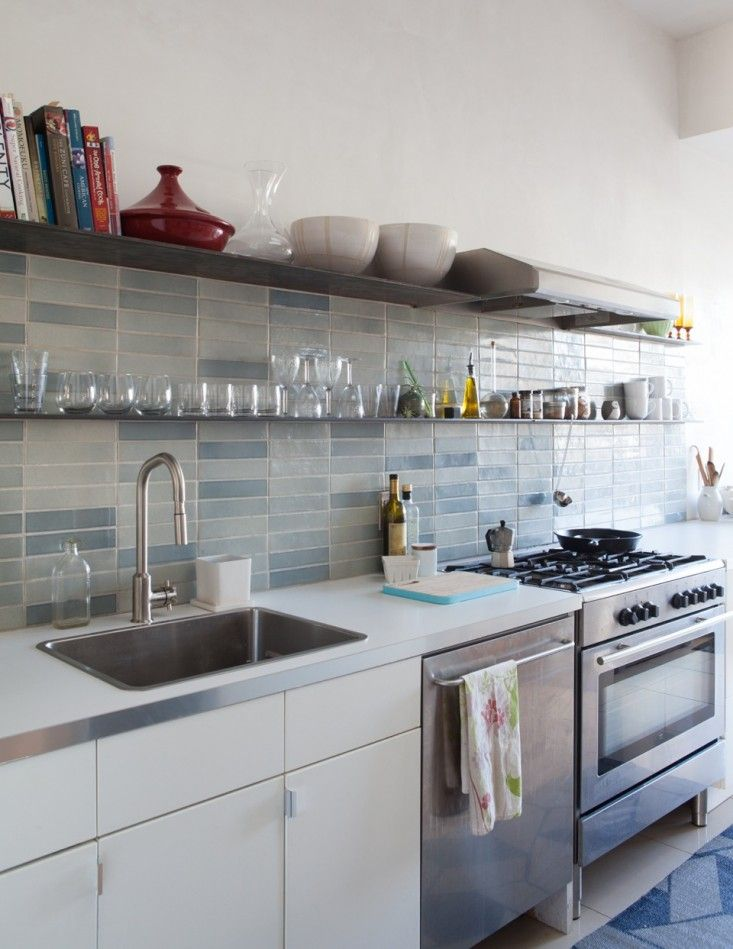Architect Ian Read's budget kitchen remodel with Ikea cabinets and counters and @Robert Heath Ceramics seconds tiles.  Remodelista