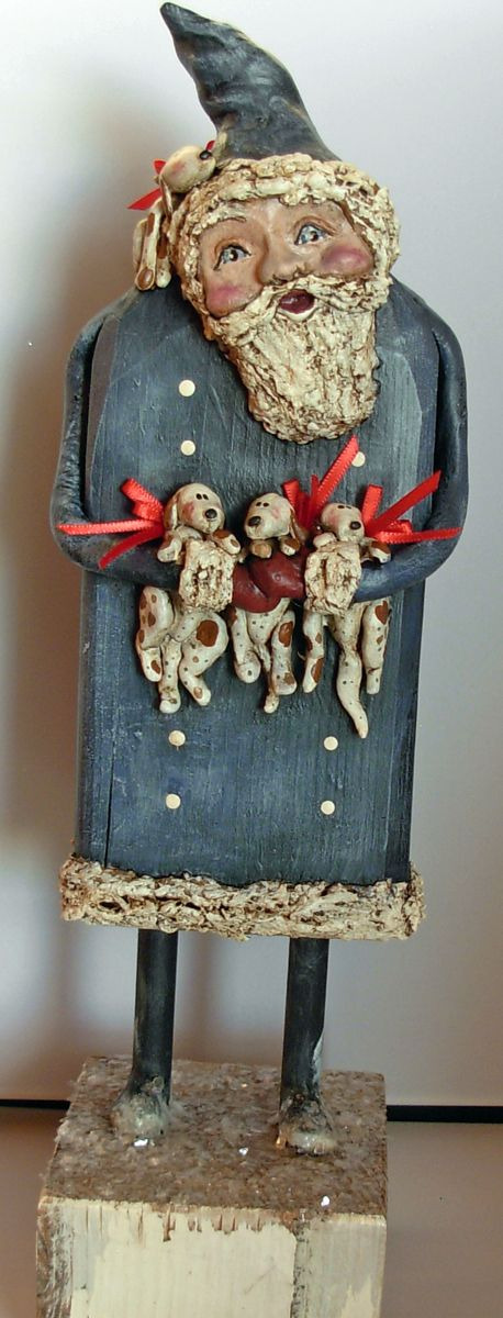 >BOY HOWDIE PAPIER MACHE FOLK ART by Dawn Tubbs.  Folk art blue Santa with Puppies, wood and papier mache.