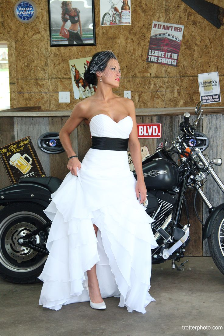 We love the contrast in this picture between the beautiful white dress and the black motorcycle.