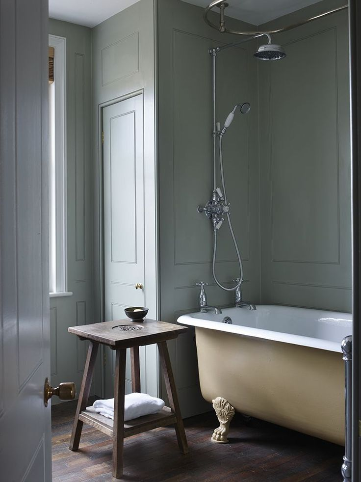 Lovely dusty green walls especially with the dark wood floors