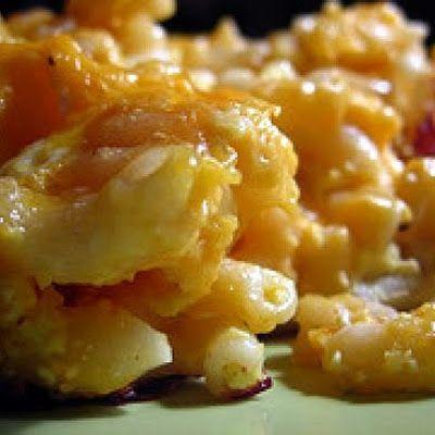 VELVEETA CHEESE BAKED MACARONI    1    pkg. (8 oz.) elbow macaroni        2-½    tbsp. butter, melted        ½    tsp. salt        2    tbsp. flour        ⅛    tsp. pepper        1-¾    c. milk        8    oz. Velveeta, cubed        ⅓    c. bread crumbs        1    Tbs. melted butter