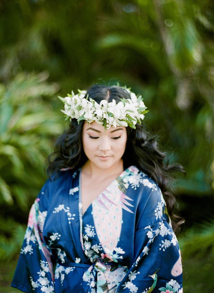 Pretty Hawaiian flower crown + robe: Photography: Aria Studios - ariastudios.com   Read More on SMP: http://www.stylemepretty.com/destination-weddings/hawaii-weddings/2016/07/15/best-wedding-backdrop-ever/