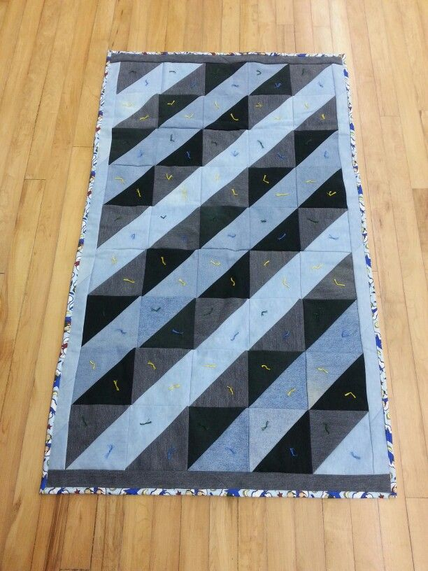 I had fun playing with different colours of denim to come up with this design.  A charity quilt.  Oct. 2014