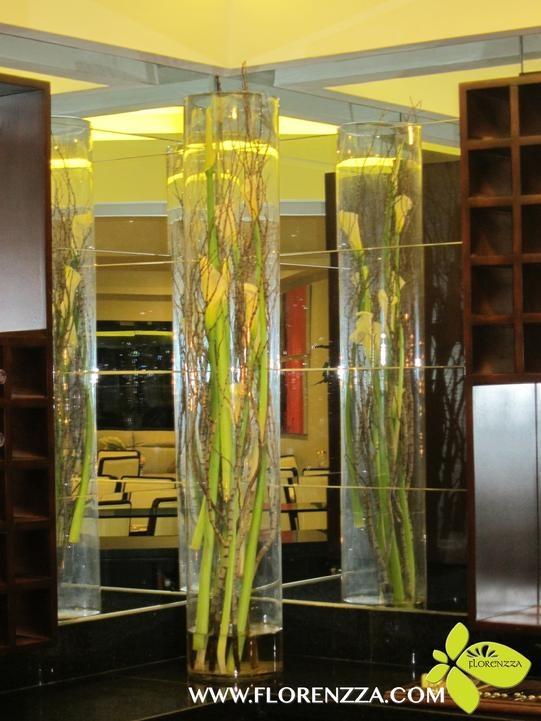 Calla lilies inside tall vase
