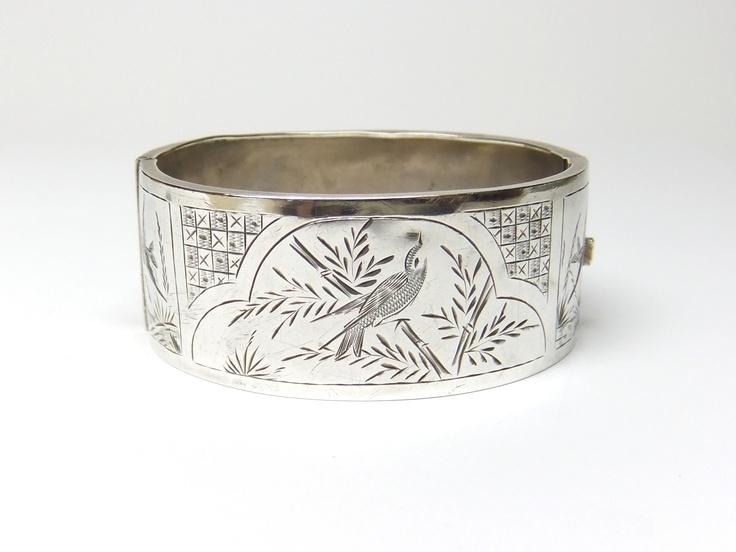 Silver bangle with bird engraving