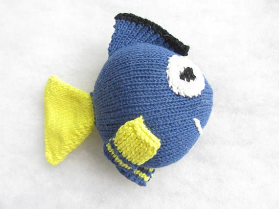 Hand knit cotton Dory baby rattle.