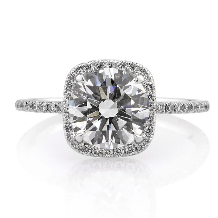 Exquisite round diamond with a cushion halo engagement ring by Mark Broumand