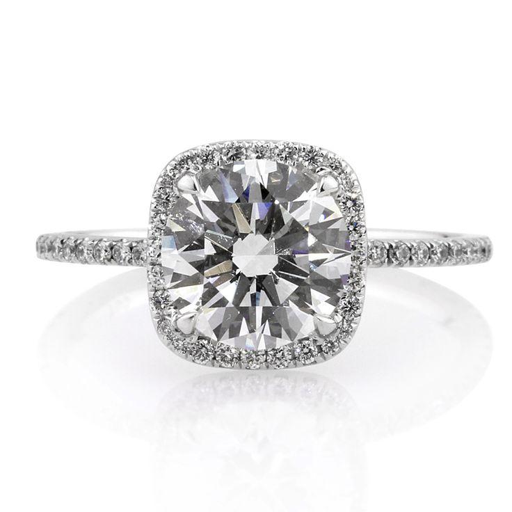Beautiful round cut diamond with a diamond halo :D So beautiful!! I wish!!