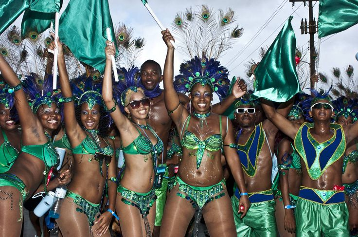Costumed revelers celebrate Crop Over in Barbados during the Kadooment Day parade. via gocaribbean.about.com
