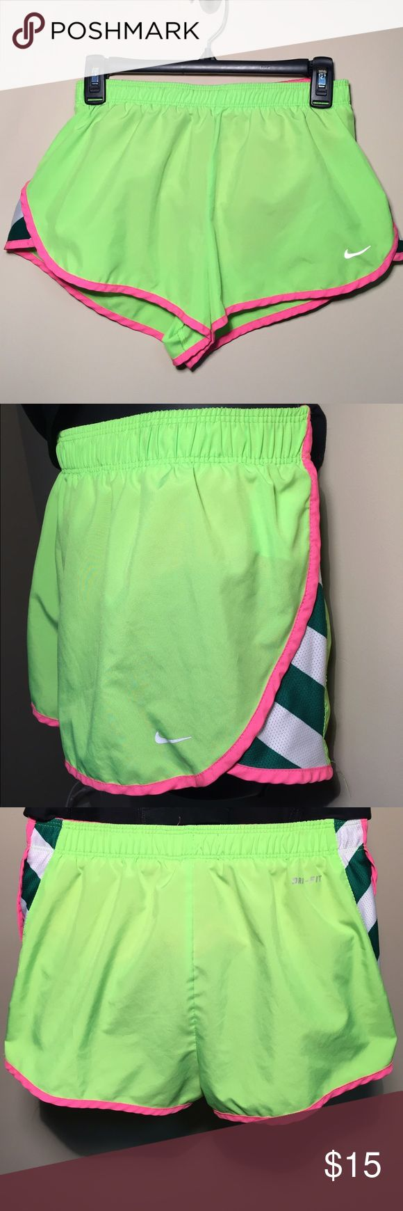 Nike Lime Green Running Shorts with Pink Piping Lime green running shorts with pink piping and green/ white striped side; excellent used condition; 13 inch waist; built in briefs Nike Shorts