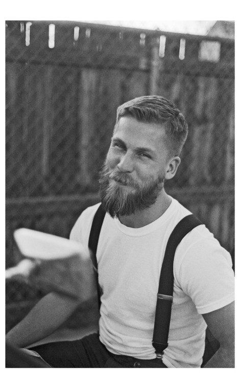 all of this man. Just all it. The suspenders..the plain white tee...the long shaped beard with short hair..that sweet smile...winning.