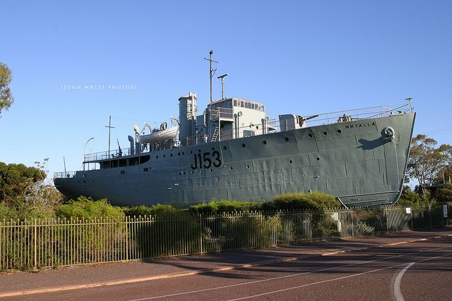 'Whyalla' - photo by John White, via Flickr;  The ship HMAS Whyalla (J153) was named for Whyalla, South Australia, and was one of 60 Bathurst class corvettes (a class of general purpose vessels) constructed during World War II.  After the war she was used as a maintenance ship until she was purchased in 1984 by the Whyalla City Council, who put her on display as a landlocked museum ship.