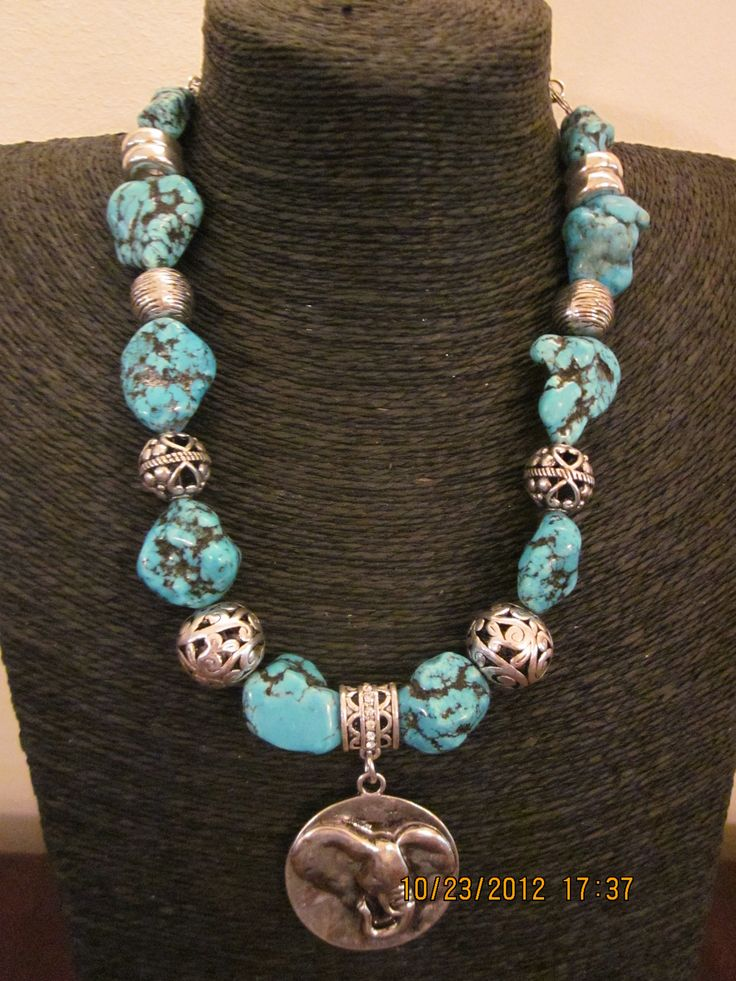 Fabricated turquoise beads and elephant medallion necklace