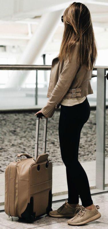 Marianna Hewitt + maximum comfort + travel– black leggings + designer trainers + great option + still looking fashionable on the road.
