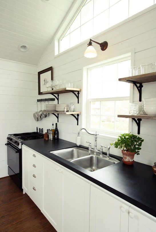 I LOVE these shelves framing kitchen sink. Getting things off the counter.