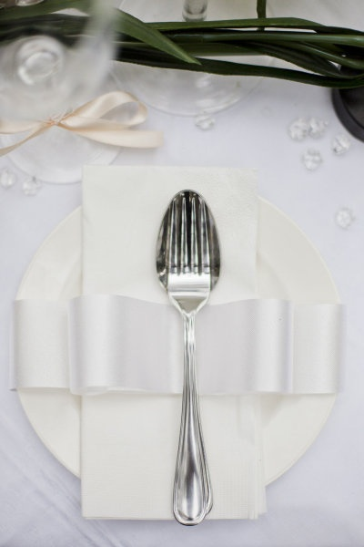 Simple white romantic place setting.
