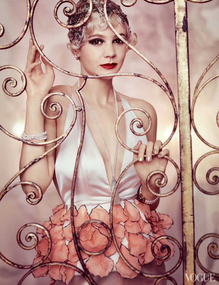 Carey Mulligan in a Dior Haute Couture top, sautoir from Stephen Russell, and bracelets from Gray & Davis, Ltf. Headpiece created by Julien d'Ys. #Vogue #TheGreatGatsby