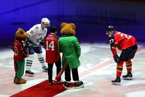Cermonial puck drop with Nick Bjugstad, Hendrik Sedin and Hikaru Nakamura. Vancouver Canucks, Florida Panthers, March 16, 2014, BB&T Center