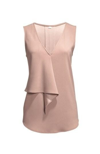A flirty twist on a classic v-neck top.