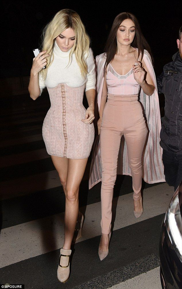 Supermodel strut: Kendall took the lead as she sashayed into the party with Gigi close beh...