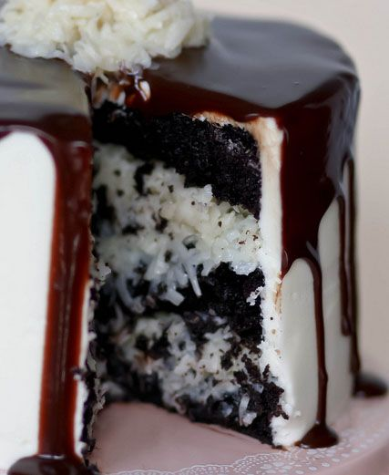 Mounds Layer Cake Recipe ~ Rich, dark chocolately chocolate cake, coconut filling (like the center of a Mounds bar), creamy coconut buttercream, and a smooth layer of dark chocolate ganache.