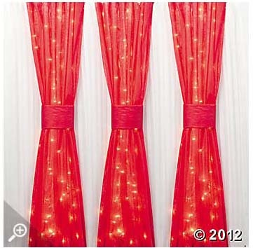 Gossamer and lights decor idea (from www.orientaltrading.com) - want a darker red - also black and cream