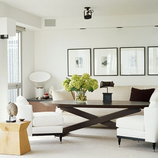 image shows purposeful use of larger scale furniture pieces balanced with smaller occasional chairs and side. Interior Design Ideas. Home Design Ideas