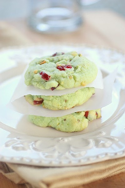 1 pouch Betty Crocker Sugar Cookie Mix 1 box (4 serving size) pistachio instant pudding and pie filling mix 1/4 cup flour 1/2 cup butter, melted 2 eggs 1 cup dry roasted salted pistachio nuts, chopped 1/2 cup dried cranberries, chopped optional - green food coloring (I didnt add any but if you wanted them extra green you could) 350 degrees for 8-10mins