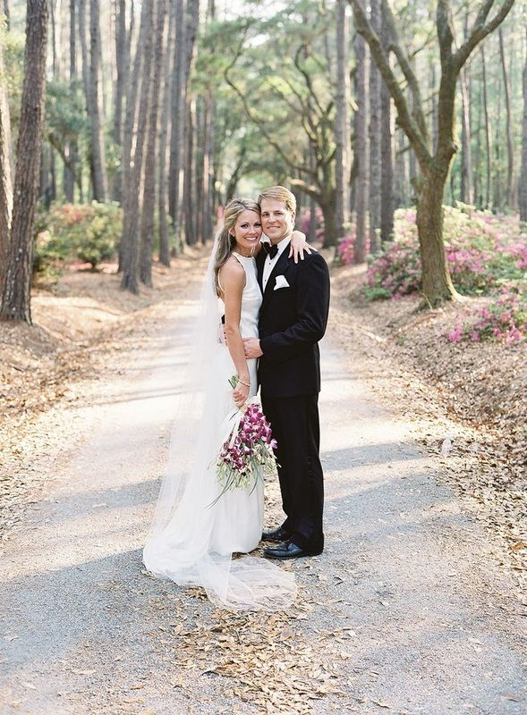 bride and groom standing in pathway hugging, Cameran Eubanks and Dr. Jason Wimberly on their wedding day http://itgirlweddings.com/cameran-eubanks-southern-wedding/