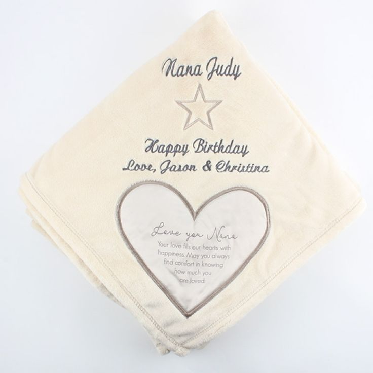 "Nana Royal Plush Blanket  50x60 - Wrapped in warmth and love...forever touched by sweet memories, this soft plush blanket will be a treasured gift. It comes with a satin heart applique in one corner that is full of comforting words. Our embroidery specialists can make this blanket personal by adding your own message above the satin heart.  Message inside satin heart reads ""Love you Nana. Your love fills our hearts with happiness. May you always find comfort in knowing how much you are…"