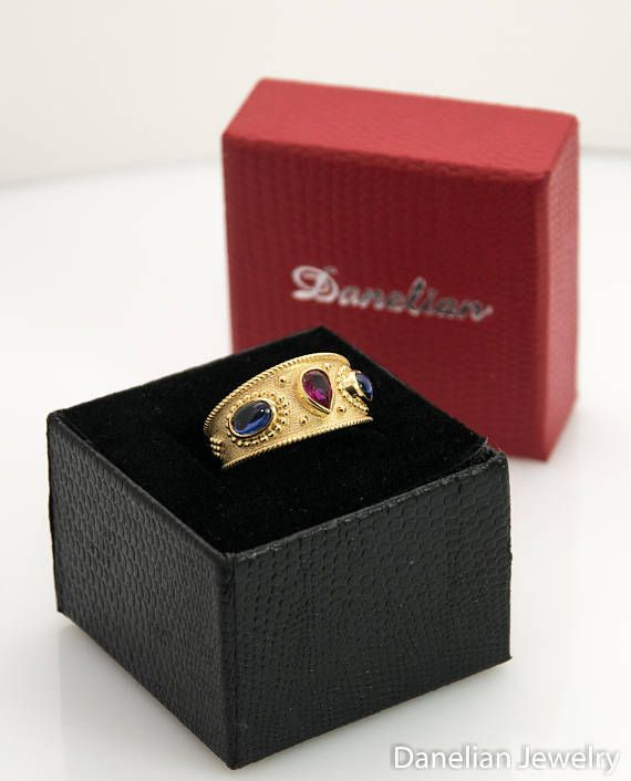 From ancient times to today, created in our goldsmith workshop with the finest details. Byzantine Jewelry / Greek Jewelry decorated with sapphire and ruby gemstones. Makes a wonderful example for a statement or special event gold band. #danelianjewelry #byzantine #jewelry #etruscan #gold #ring #ruby #sapphire