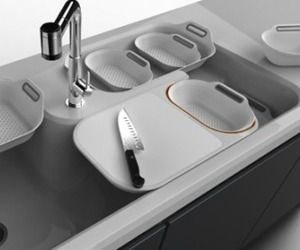 Designed by Wu Chun Ming this kitchen sink system contains several creative features that improve the experience of food preparation. The core design is based on simplifying the procedures required for preparing food by segregating/segmenting the functions of cutting, washing and stacking. The key elements are a colander, a set of specially designed containers, a sliding/removable cutting board and a center mounted faucet. Winner of a 2012 Red Design Award