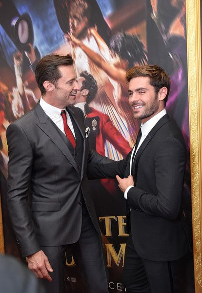 """Zac Efron Photos - Actors Hugh Jackman (L) and Zac Efron attend the """"The Greatest Showman"""" World Premiere aboard the Queen Mary 2 at the Brooklyn Cruise Terminal on December 8, 2017 in the Brooklyn borough of New York City. - """"The Greatest Showman"""" World Premiere"""