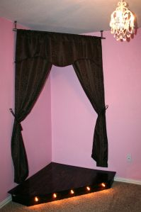 DIY Kids Stage - make a corner of her bedroom into a stage - add curtains, a lighted platform, and voila - brilliant!