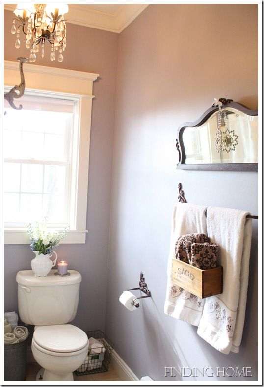a small bathroom mirror in an unexpected place - Small Bathroom Chic: