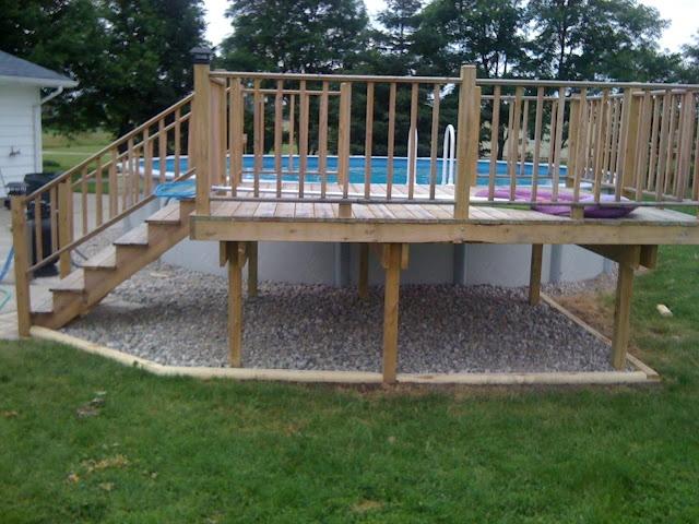 Rock under deck decks pinterest decking screened for Garden decking projects