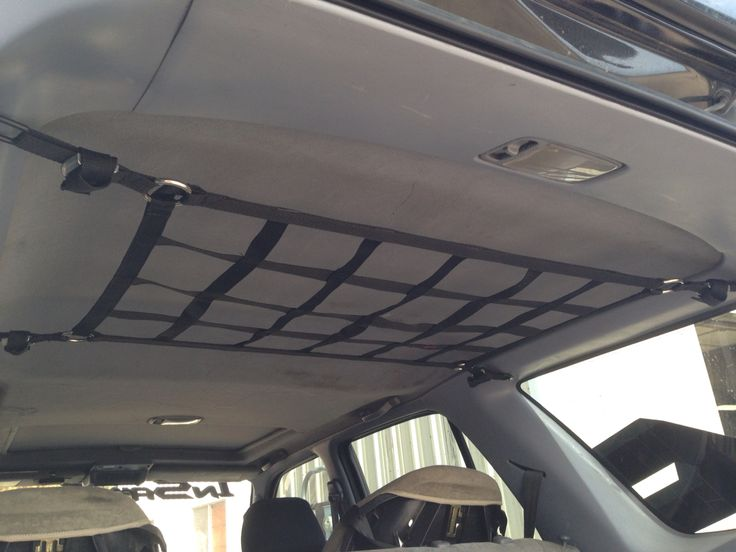 Ceiling net in 3rd gen 4Runner, mounted with 200# anchor points, adjustable down for bags, jackets etc.  flush and out of view for everyday use.  #RAINGLERNETS #TOYOTASTORAGE #4RUNNERCAMPING