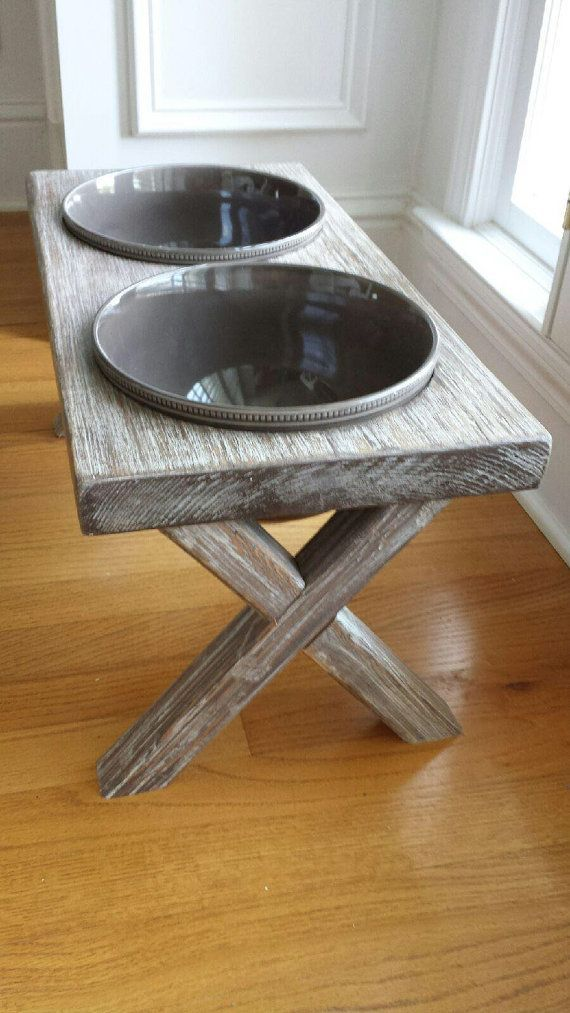 Farm Table Dog Bowl This one of a kind dog bowl is handcrafted and unique it is the perfect for your best friend! The bowls are easily removable and are dishwasher safe. Each bowl fits approximately 12 cups of food and or water.  ANY SIZE CUSTOM DOG BOWL CAN BE BUILT!!!!   •Reclaimed Wood •Distressed •Whitewashed •Easy Use •Unique •Handmade  Table Size: •23long •12tall •11.5 wide  Bowl Size •9.5diameter •5 deep  Approximate weight to ship 14 lbs.  If interested in another color, click on the…