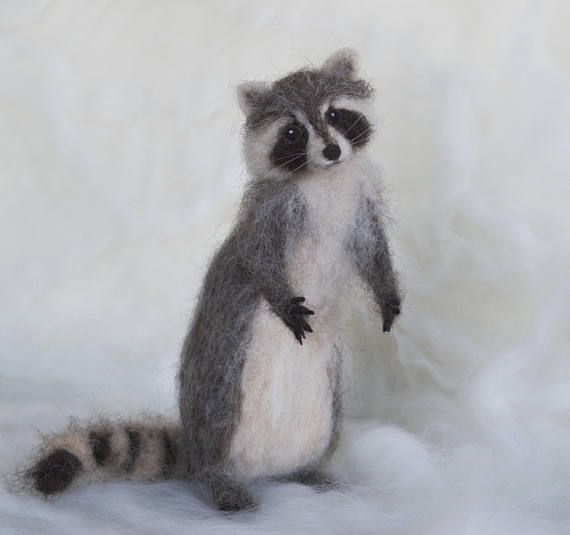 Here is a playful raccoon. He is very poseable and can climb, stand on two feet and a tail, run . . . This raccoon is 9 inches long from head to tail. He stands 6.5 inches high. The raccoon was created by needlefelting and is made entirely of wool. The soft alpaca, undyed give him