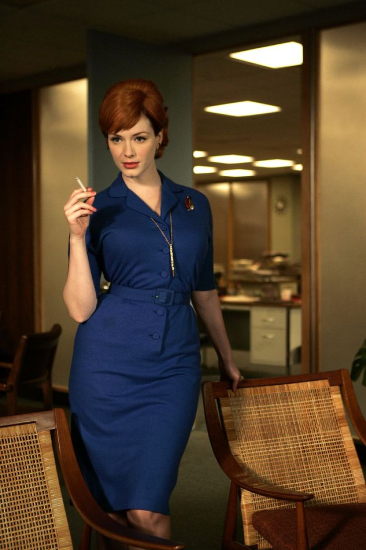 Christina Hendricks as Joan, wearing the hell out of that royal blue shirtdress.