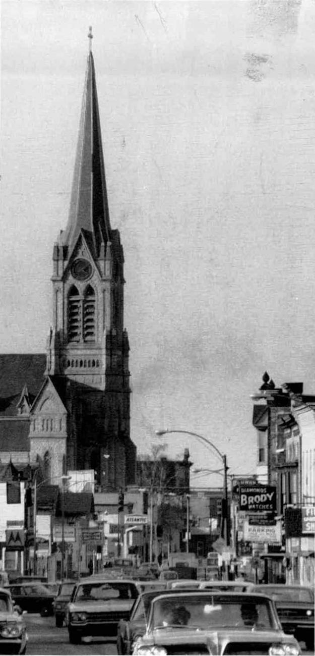 St. Michael's Catholic Church |      Spire of St. Michael's on guard over busy city. (Gordon Massecar Photo, 1968) DC 3/26/1968